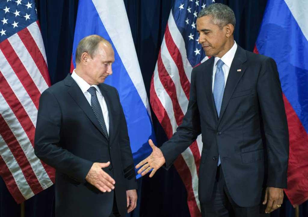 Vladimir Putin i Barak Obama (Foto: Beta)